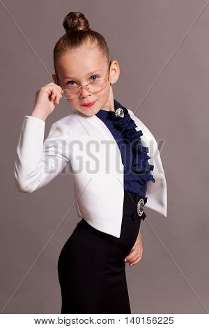 little girl in glasses dressed as business Lady