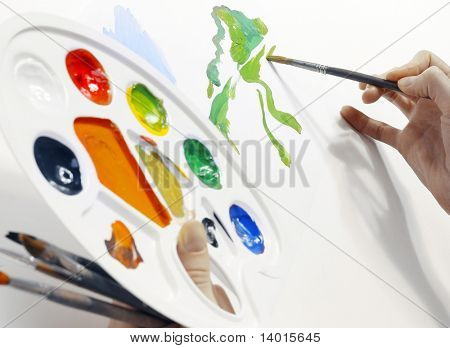 Hand with brush and palette
