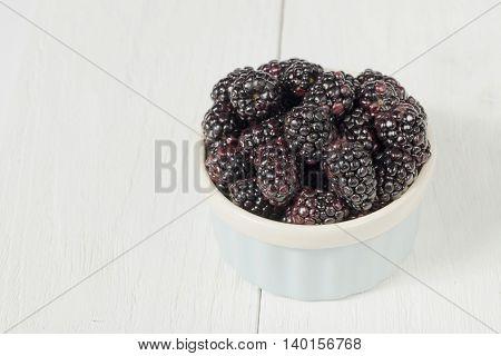 top view image of blackberries on bowl