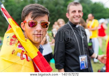 Poznan POLAND - JULY 24 2016: young Spanish pilgrim in Poznan - during Days In Dioceses just before The World Youth Day in Krakow; WYD is a meeting of youth from all over the world