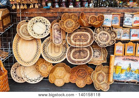 VELIKY NOVGOROD RUSSIA-JULY 22 2016. Handmade plates made of birch bark with various forms and patterns - traditional Russian Slavic handmade tableware. Souvenir trade.