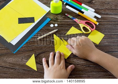 The Child Makes A Book With A Bookmark Mignon. The Child Bonded Items Paper Products. Glue, Paper, S