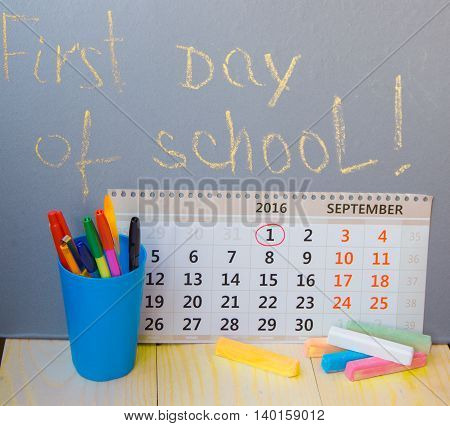 First day at school writing on the blackboard calendar stationery.