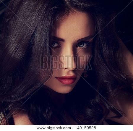 Seductive Makeup Brunette Woman With Long Hair Posing On Dark Background. Toned Closeup Portrait