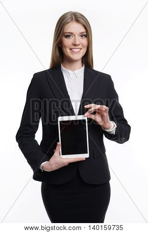 Business woman holding a tablet computer to take . European appearance. On a white background in a business suit .