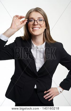 Eyewear glasses woman happy holding showing her new glasses smiling on white background. Beautiful young female model in her twenties.
