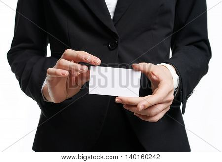Businesswoman showing and handing a blank business card. Business woman in black suit Isolated on white background.