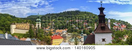 Banska Stiavnica panoramic view with old castle, knocking tower and houses by day, Slovakia