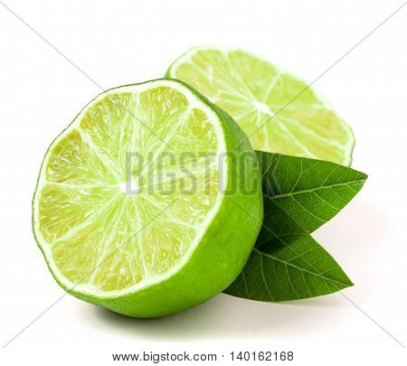 Lime halves with leaf isolated on white background.