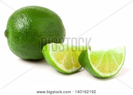 lime with slices isolated on white background.