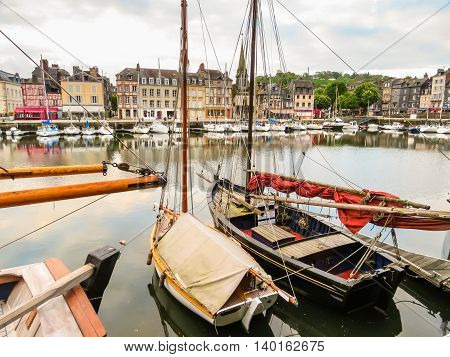 Fishing boats in the old port of Honfleur, Normandy, France