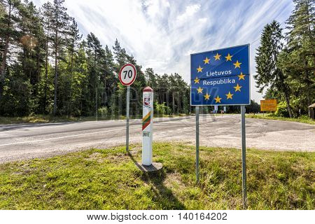 Lithuania country border sign between Latvia and Lithuania with coat of arms and flag. EU flag sign with lithuanian text the Republic of Lithuania.
