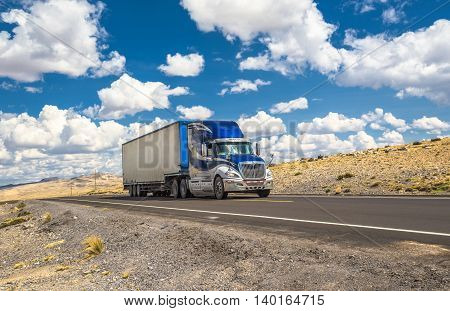 Highly detailed image of blue truck moving on a highway