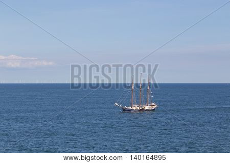 Puttgarden, Germany - July 26, 2016: A sailboat in the Baltic Sea between Puttgarden in Germany and Rodby in Denmark.