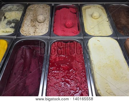 Scoop of colorful ice cream in the glass cabinet