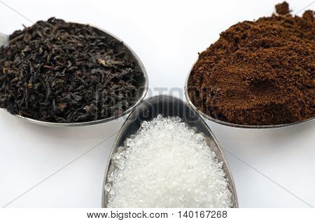 Tea, coffee and sugar in a spoon close-up