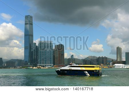 Hong Kong West Kowloon Skyline and Historical Star Ferry in Victoria Harbour, Kowloon, Hong Kong. The International Commerce Centre (ICC) at the center is the tallest building in Hong Kong.