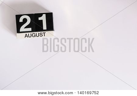 August 21st. Image of august 21 wooden color calendar on blue background. Summer day. Empty space for text.