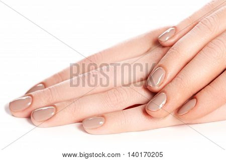 Beautiful Female Finger Nails With Beige Nail Closeup On Petals.