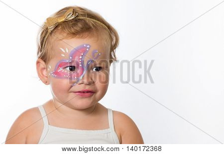 Lovely Baby Girl With Paintings On Her Face Of A Butterfly