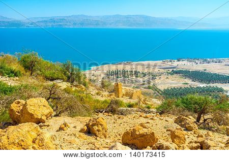 The mountain in Judean Desert with the view on kibbutz agriculture area on the Dead Sea coast Israel.