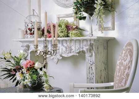 Beautiful decoration wedding ceremony.  Bright luxury  interior living room with flowers in vases.