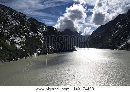 lake at grimsel pass in swiss alps