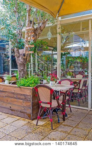 The outddor green terrace of the tavern in German Colony Haifa Israel.