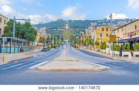 HAIFA ISRAEL - FEBRUARY 20 2016: The long Ben Gurion Boulevard leads to the Carmel Mount with the scenic gardens and Temple of Bahai on February 20 in Haifa.