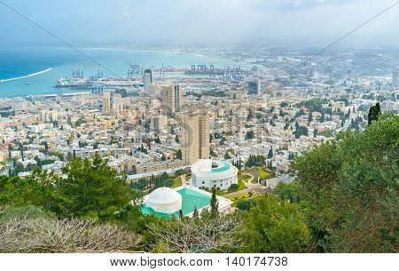 The aerial view on the city of Haifa its modern districts and industrial port Israel.