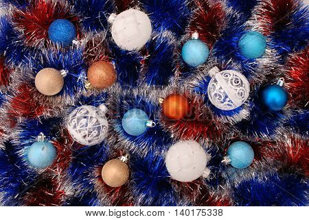 Tinsel - Christmas decoration close-up. Christmas color background