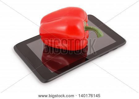 Red pepper on a tablet PC. Photo with clipping path