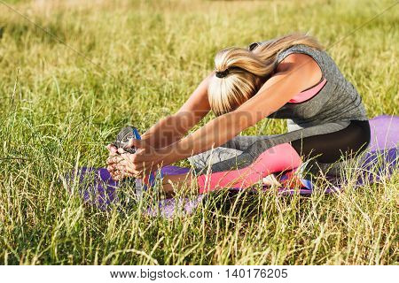 Young Woman Makes Sport Exercise