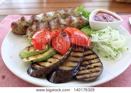 Plate With Kebab And Grilled Vegetables