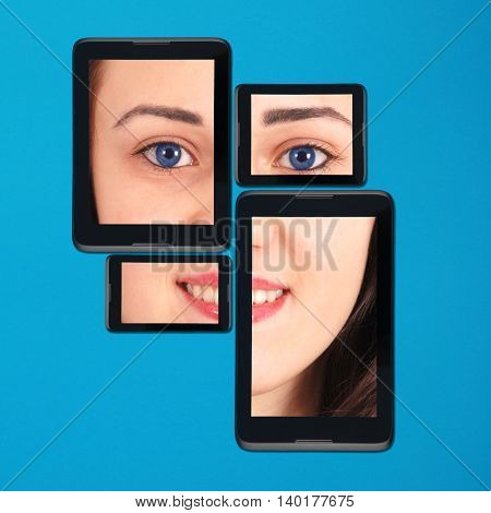 Portrain teenage girl on tablet pc and smartphone lying side by side isolated on blue background with soft shadow