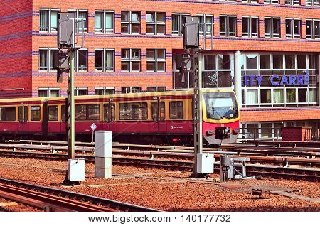 Berlin Switzerland - June 06 2010: S-bahn passenger train approach to the platform.
