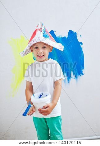photo of little happy boy with colorful brush