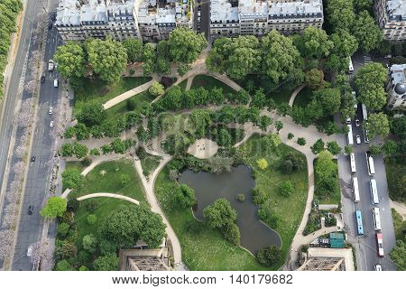 PARIS, FRANCE - MAY 12, 2015: This is a square with a pool between North and East pillars of Eifel Tower.