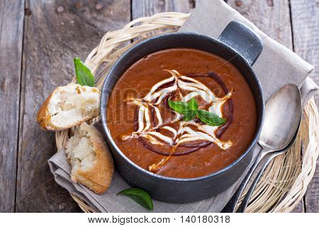 Spicy tomato soup with cream and rustic bread