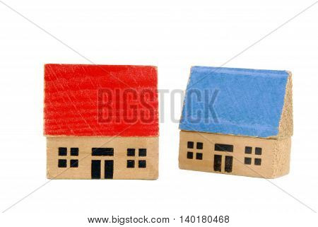 close up of the two miniature wooden houses