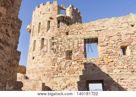 castle with battlements and walls of red stones, Villafames rural villa in Castellon, Valencia region in Spain