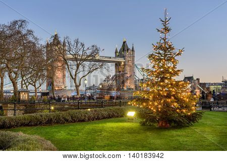 Tower Bridge is a combined bascule and suspension bridge in London and crosses the River Thames.