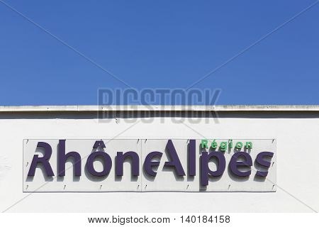 Bourg en Bresse, France - June 29, 2016: Region Rhone Alpes in France sign on a wall. Rhone Alpes is a former administrative region of France