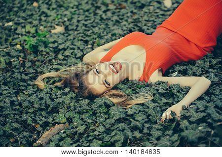 Smiling Girl Lying On Green Leaves
