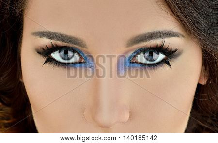 Portrait Of Sexy Fashion Model Girl With Perfect Bright Makeup. Beautiful Woman With Long False Eyel