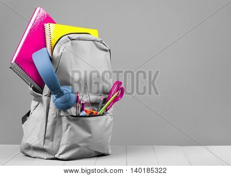 Backpack on grey background