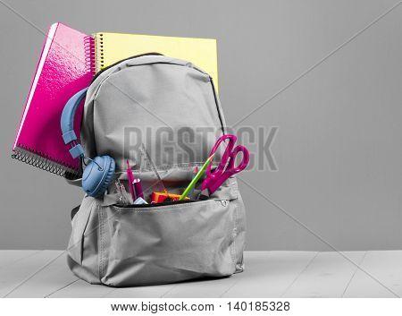 Schoolbag on grey background
