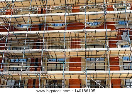 Fragment of scaffolding against house wall in Central London