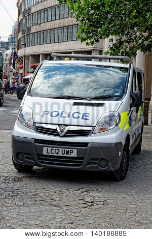 LONDON UK - JULY 1 2014: London Metropolitan Police vehicle in the City of London. The Met was formed in 1829 and as of 2011 employed 48661 staff making it one of biggest employers in London.