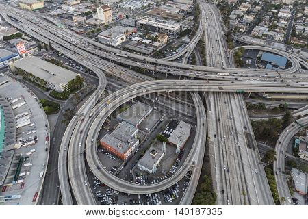Los Angeles, California, USA - July 21, 2016:  Dusk aerial of the Santa Monica 10 and Harbor 110 freeway interchange near downtown Los Angeles.